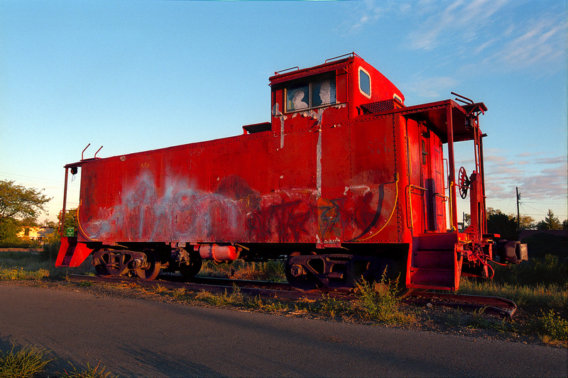Sunrise in Santa Fe, New Mexico: This old caboose meets you at the intersection of Cerrillos and St. Francis Roads and - facing South East - is beautiful at first light.